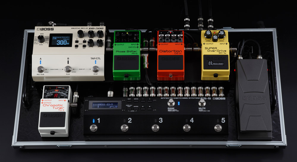 A compact pedalboard with the ES-5 effects switcher and DD-500 delay.